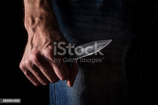 istock The man with a knife in a hand. Closeup. 589984690