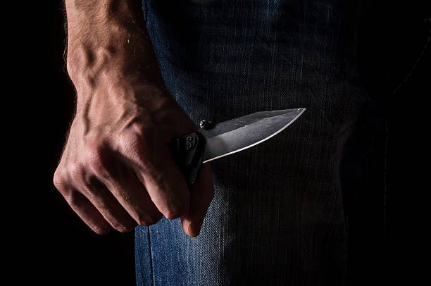 The man with a knife in a hand. Closeup. - foto de acervo