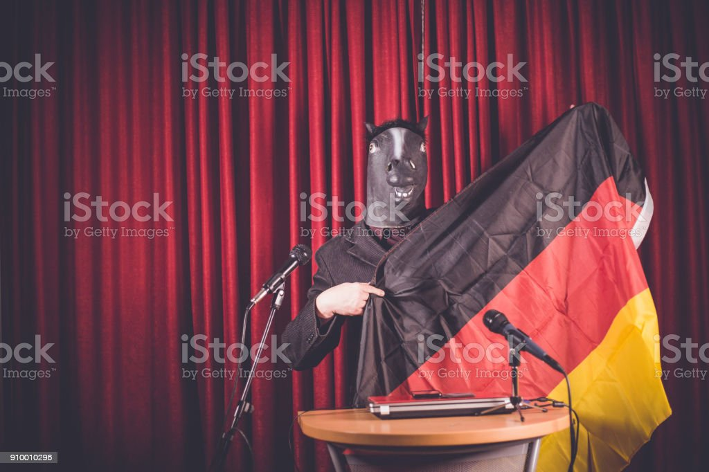 The man with a mask is holding a speech stock photo
