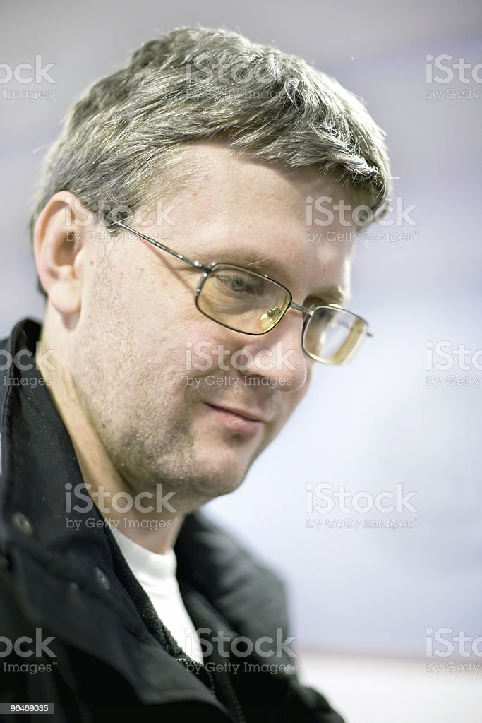 The man with glasses smiles royalty-free stock photo