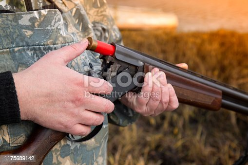 istock The man with the gun. A man and a double-barreled gun. 1175689142