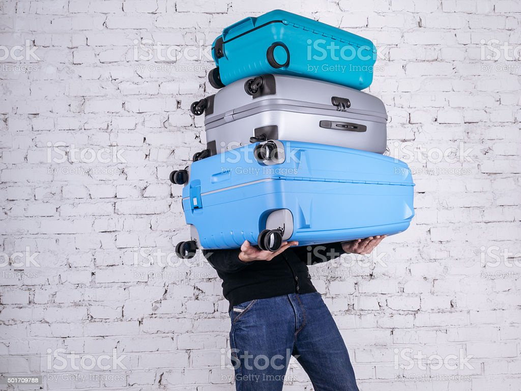 The man with the suitcases stock photo