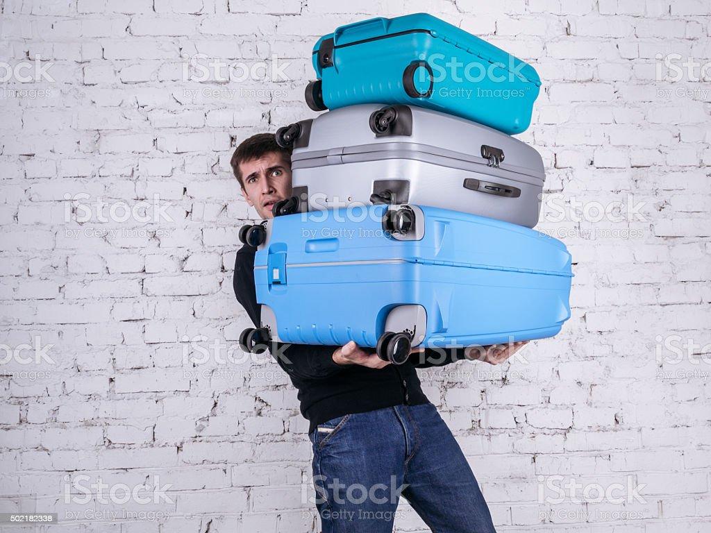 Der Mann mit der Koffer – Foto
