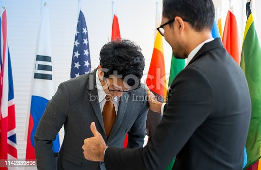 istock The manager show action of admiration to the co-worker by thumbs up acting during the international conference 1142339898