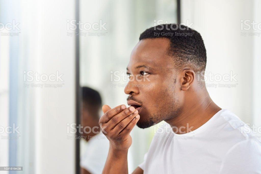 The mandatory morning breath check stock photo