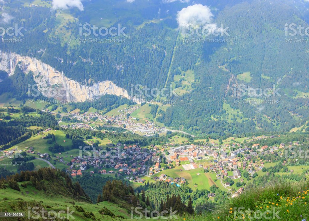 The Mannlichen's popular viewpoint over the Lauterbrunnen valley and a popular start location for hikers and skiers. Mannlichen station can be reached from Wengen or Grindelwald cableway. The summit takes 15 mins walk from the station. stock photo
