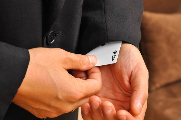 The man's hand takes off ace from sleeve stock photo