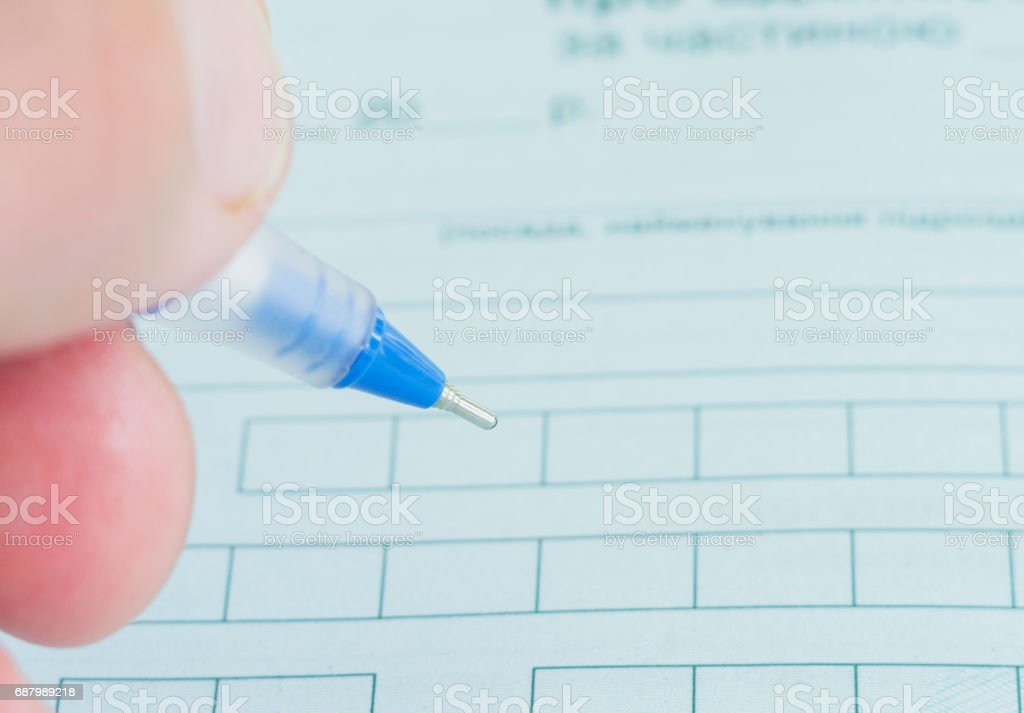 The mans hand with pen fills the contract. Loan Agreement. Selective focus. stock photo