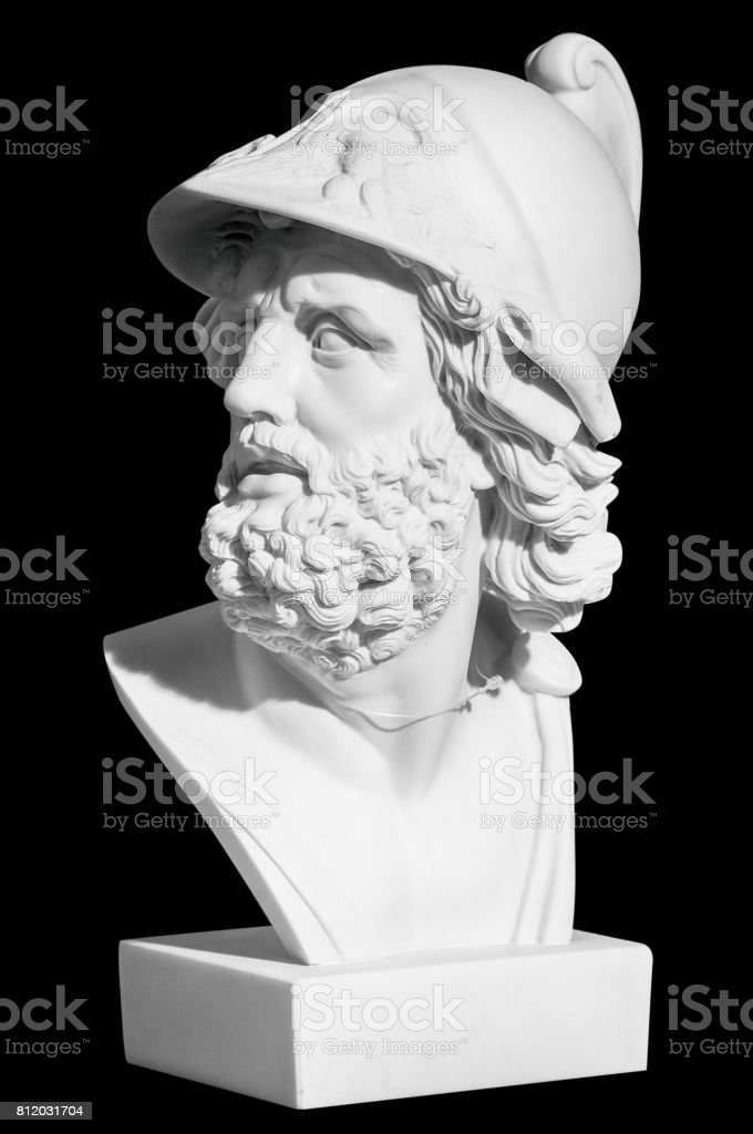 The man's head in a helmet in a classical style on a black background stock photo