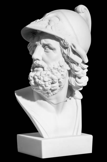 The man's head in a helmet in a classical style on a black background The man's head in a helmet in a classical style on a black background statue stock pictures, royalty-free photos & images