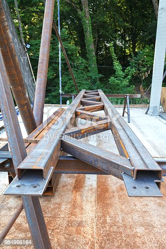 Manufacturing of a truss made of metal pipes to strengthen building structures.