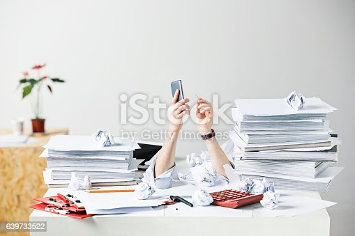 The conceptual image or collage about many of crumpled papers on the desk of stressed male workplace