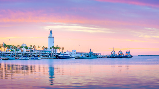 The marine of Malaga, Spain. It is a modern region of the city with museums, restaurants, entertainment, and a ancient lighthouse at the tip.
