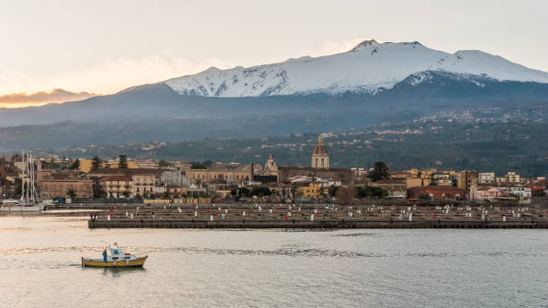 The marina of Riposto during the sunset; volcano Etna in the background stock photo