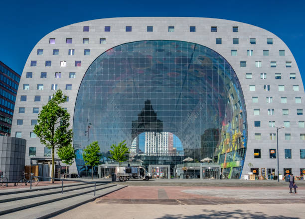 The Markthal, residential and office building with market hall underneath, located in Rotterdam. South Holland, Netherlands. ROTTERDAM - MAY 27, 2017: The Markthal, residential and office building with market hall underneath, located in Rotterdam. South Holland, Netherlands. market hall stock pictures, royalty-free photos & images