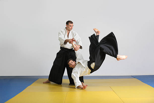 The martial art of Aikido. two men demonstrate the techniques of Aikido. stock photo
