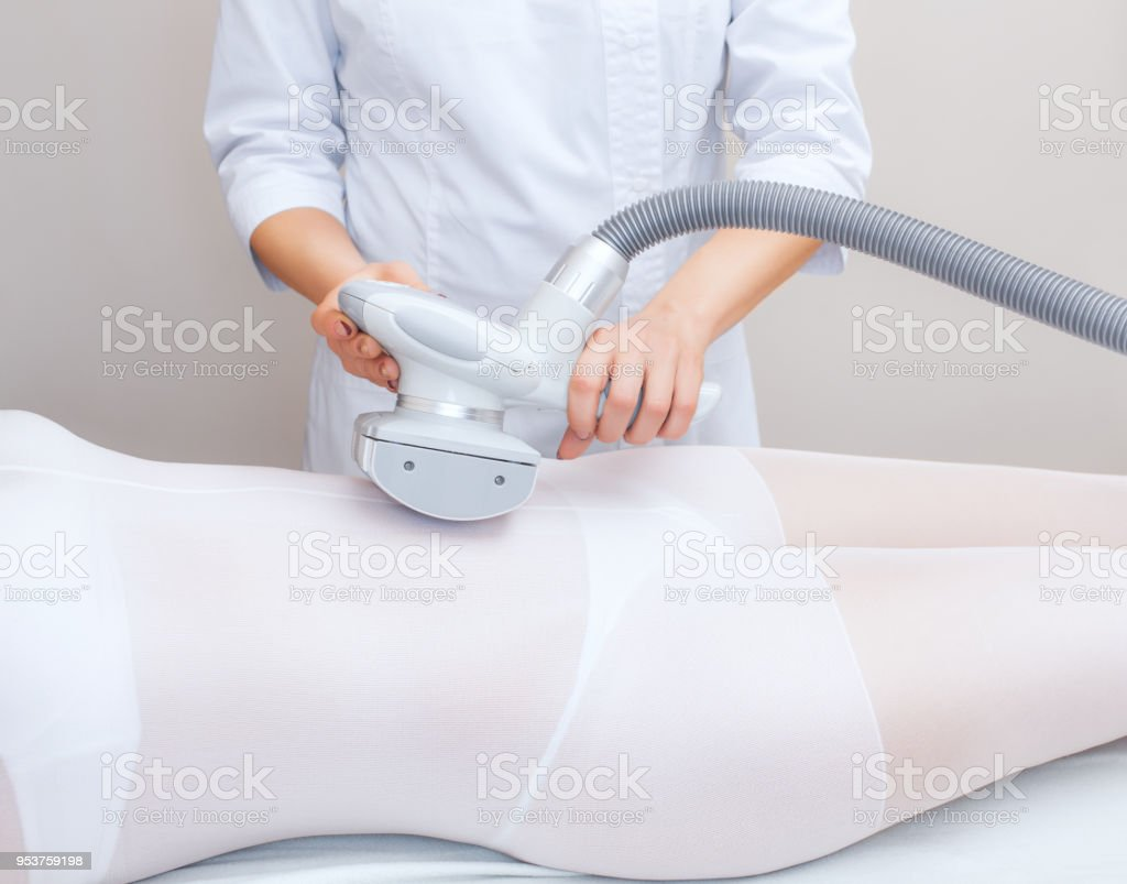 The masseur is preparing to make an  hardware anti-cellulite massage stock photo