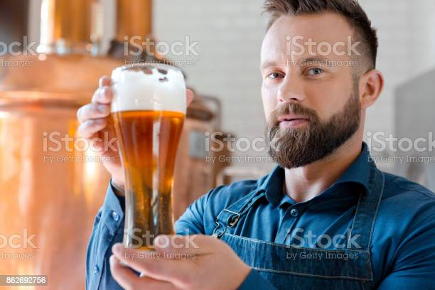 The Master Brewer Holding Beer Glass In His Micro Brewery Stock Photo - Download Image Now