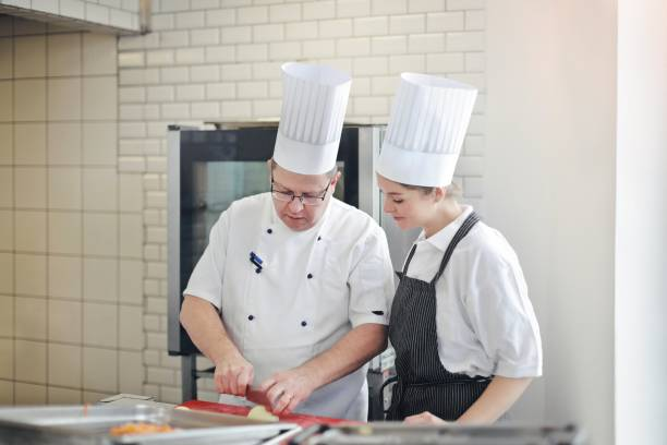 The master chef and his student stock photo