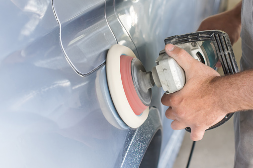 istock The master polishes the car. 950445432