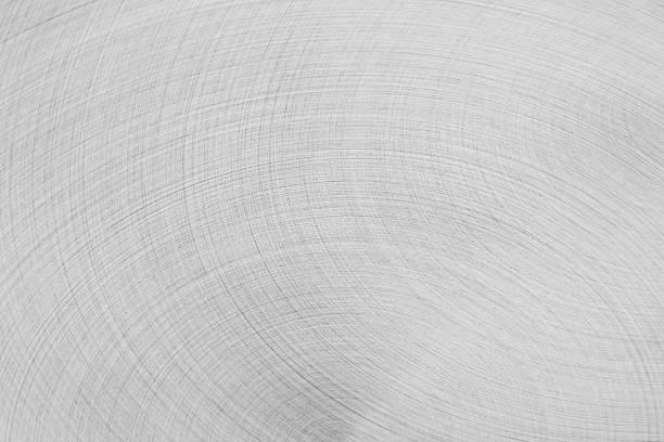 La surface en métal argenté-mat. Mouvements semi-circulaire. - Photo