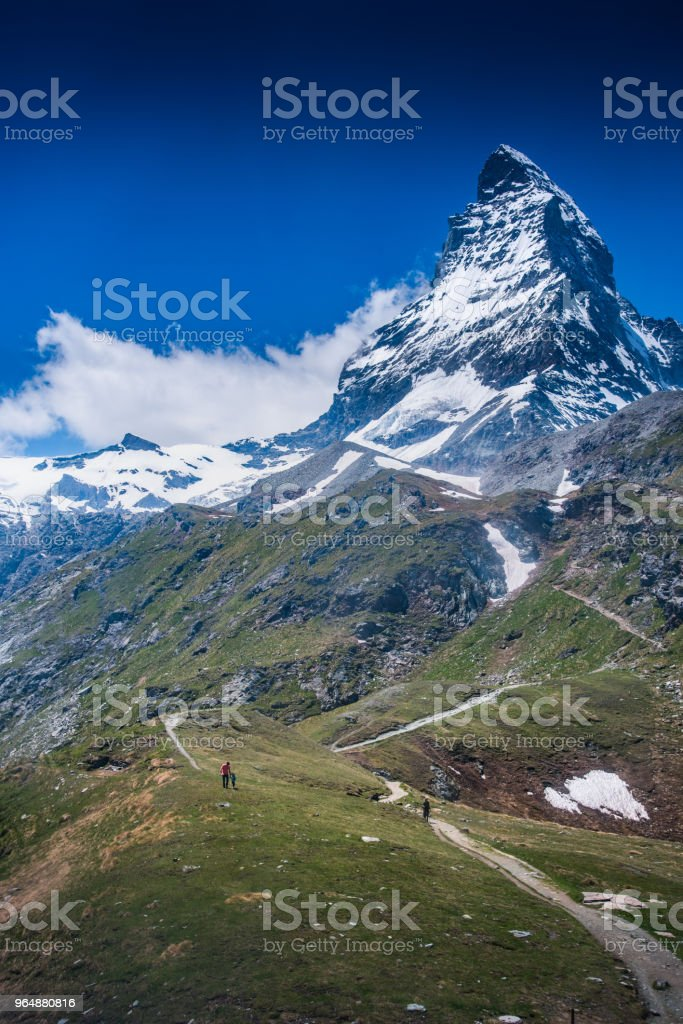 The Matterhorn with green hill royalty-free stock photo
