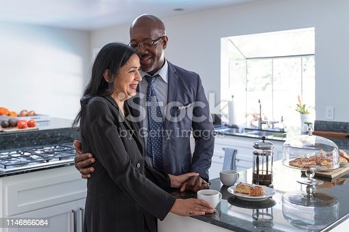 A mature couple of Latino people at home, getting ready to go outside