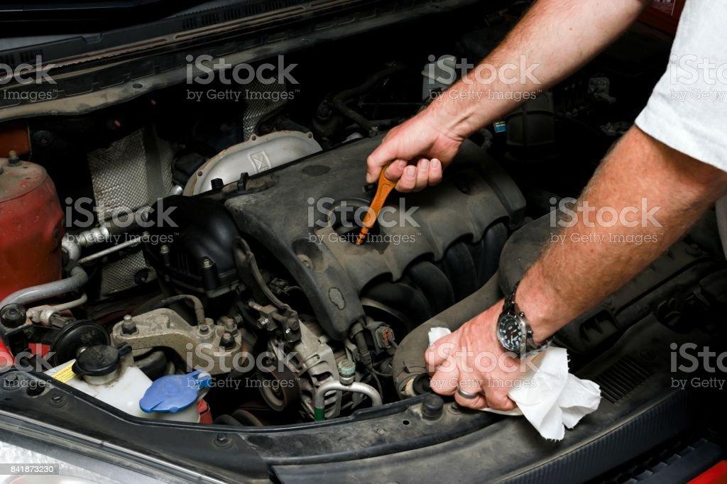 The mechanic fixes the vehicle's engine stock photo