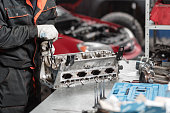 istock the mechanic opened the locking valve mechanism. Disassemble engine block vehicle. Motor capital repair. Sixteen valves and four cylinder. Car service concept. 903186974