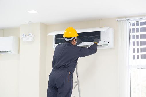 istock The mechanic Technician are Repairing Air Conditioner. 1155809088
