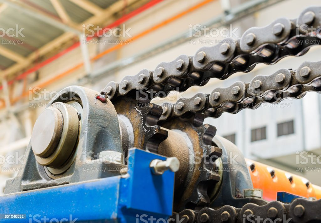 The mechanism of the chain transmission. Bearing, drive shaft, gear and chain lubrication stock photo