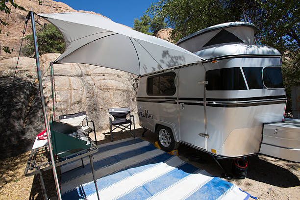 The Meerkat tiny camper is setup with awning stock photo
