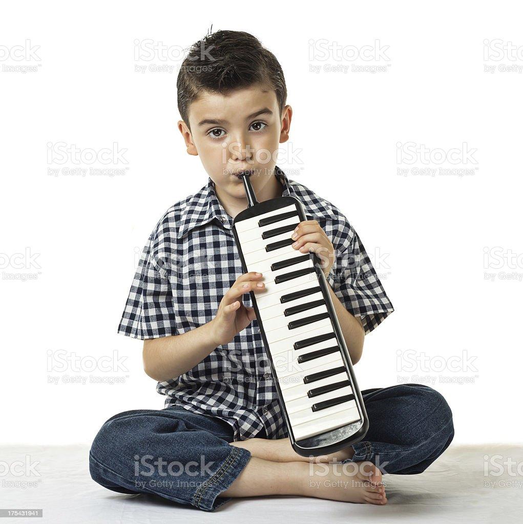 Die melodica kleine Jungen - Lizenzfrei 6-7 Jahre Stock-Foto