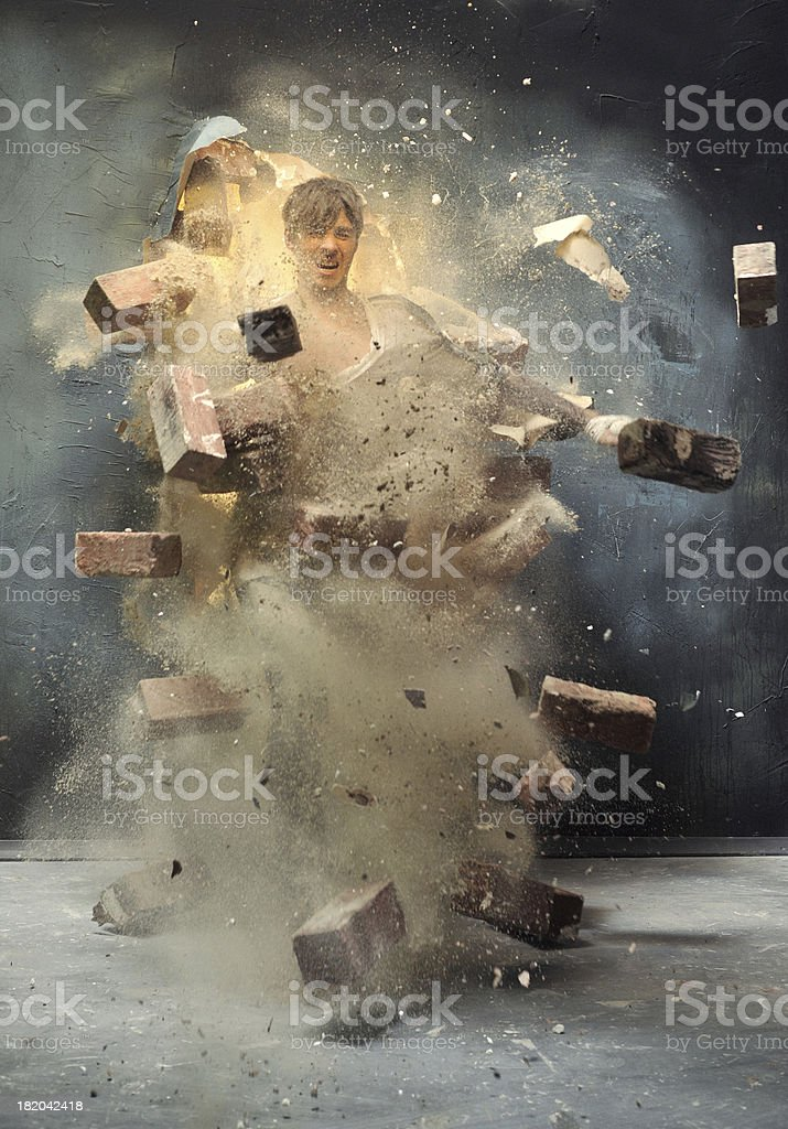 The men\tthrough broken wall stock photo