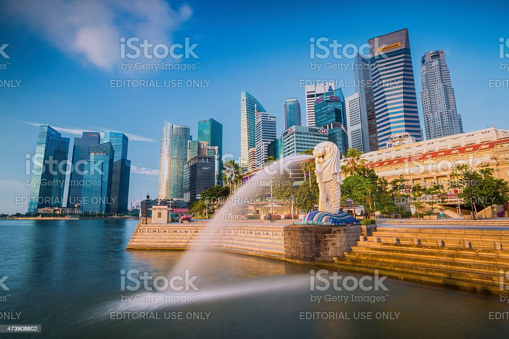 The Merlion fountain and Singapore skyline Singapore, Singapore - September 1, 2014: The Merlion fountain in front of the Marina Bay Sands hotel on September 01, 2014 in Singapore. Merlion is a imaginary creature with the head of a lion, seen as a symbol of Singapore 2015 Stock Photo