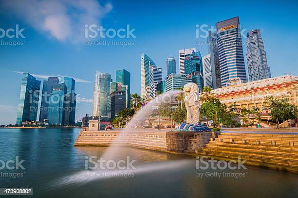 The Merlion Fountain And Singapore Skyline Stock Photo - Download Image Now