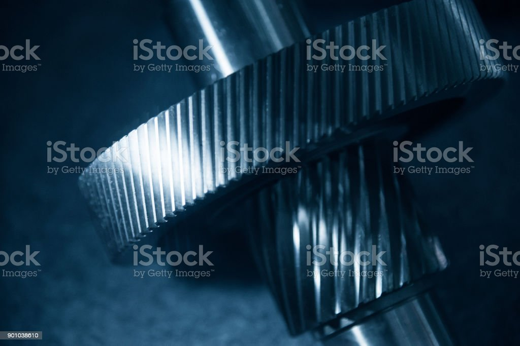 The metal gear part on metal shaft.  The mechanical part for industrial. stock photo
