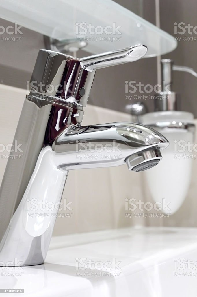 The metal tap and sink in  bathroom. royalty-free stock photo