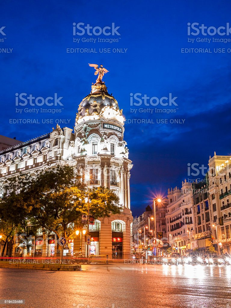 The Metropolis Building in Madrid, Spain at night stock photo