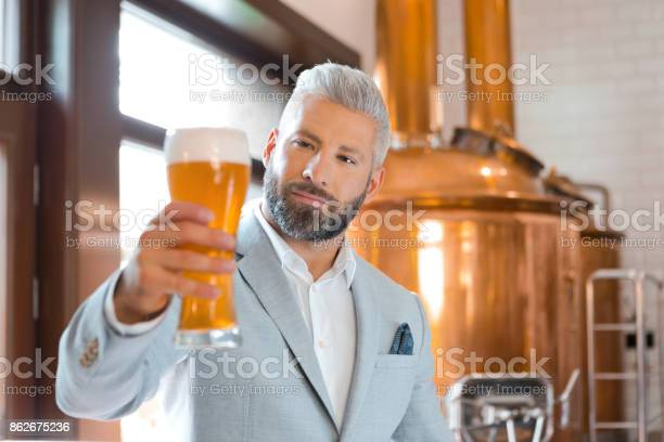 The Microbrewery Owner Holding A Beer Glass In His Pub Stock Photo - Download Image Now