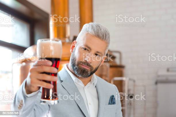 The Microbrewery Owner Holding A Beer Glass In Pub Stock Photo - Download Image Now