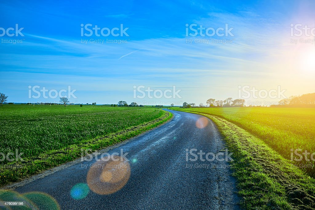 The middle of the road and lens flare stock photo