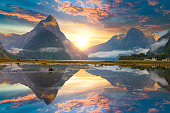 Famous Mitre Peak rising from the Milford Sound fiord. Fiordland national park, New Zealand