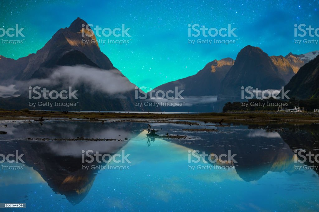The Milford Sound fiord. Fiordland national park, New Zealand with milky way stock photo