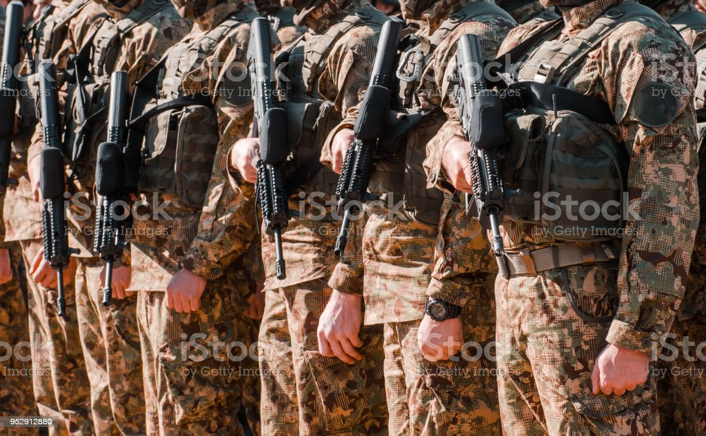 the military is kept in a weapon. The concept of protection of the country. Martial law. stock photo