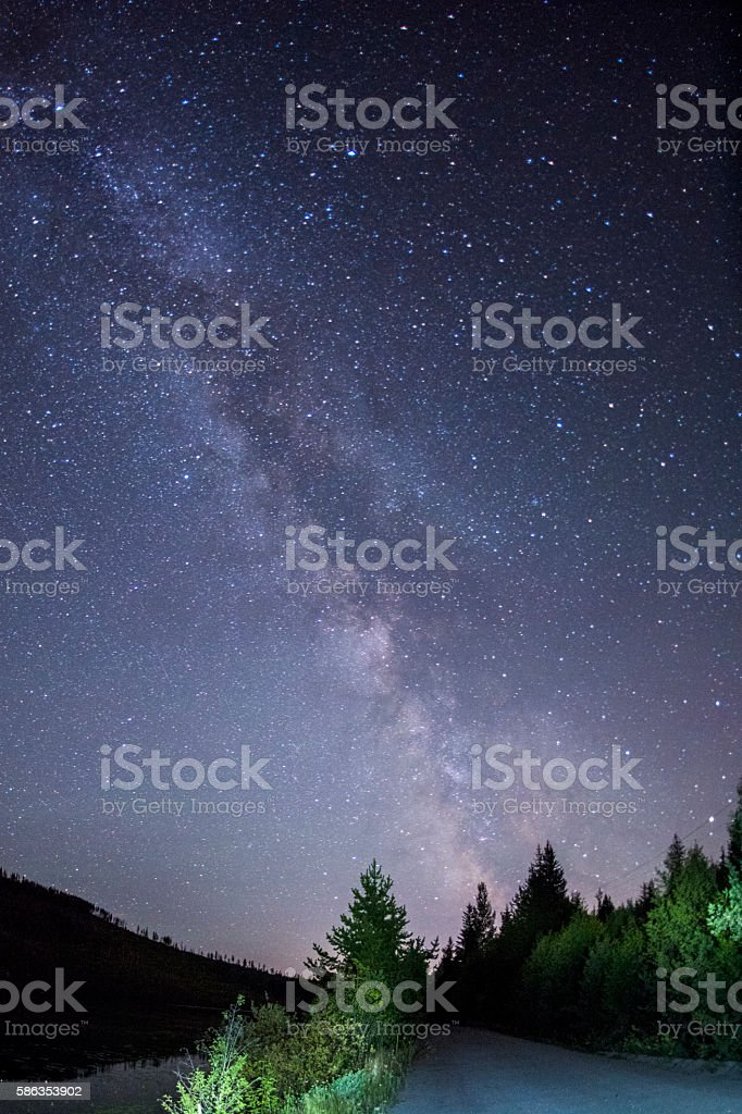 The Milky Way above a dirt road stock photo