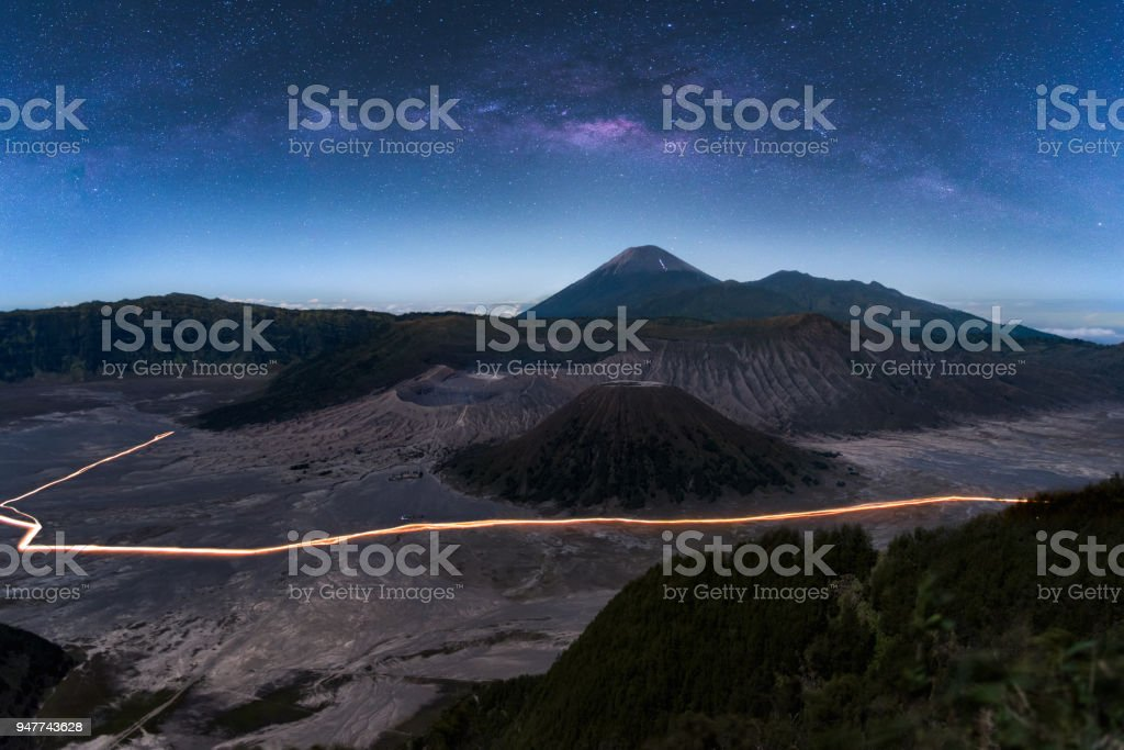 The milky way in night sky with starry over Mount Bromo volcano (Gunung Bromo) in Bromo Tengger Semeru National Park, East Java, Indonesia.. stock photo