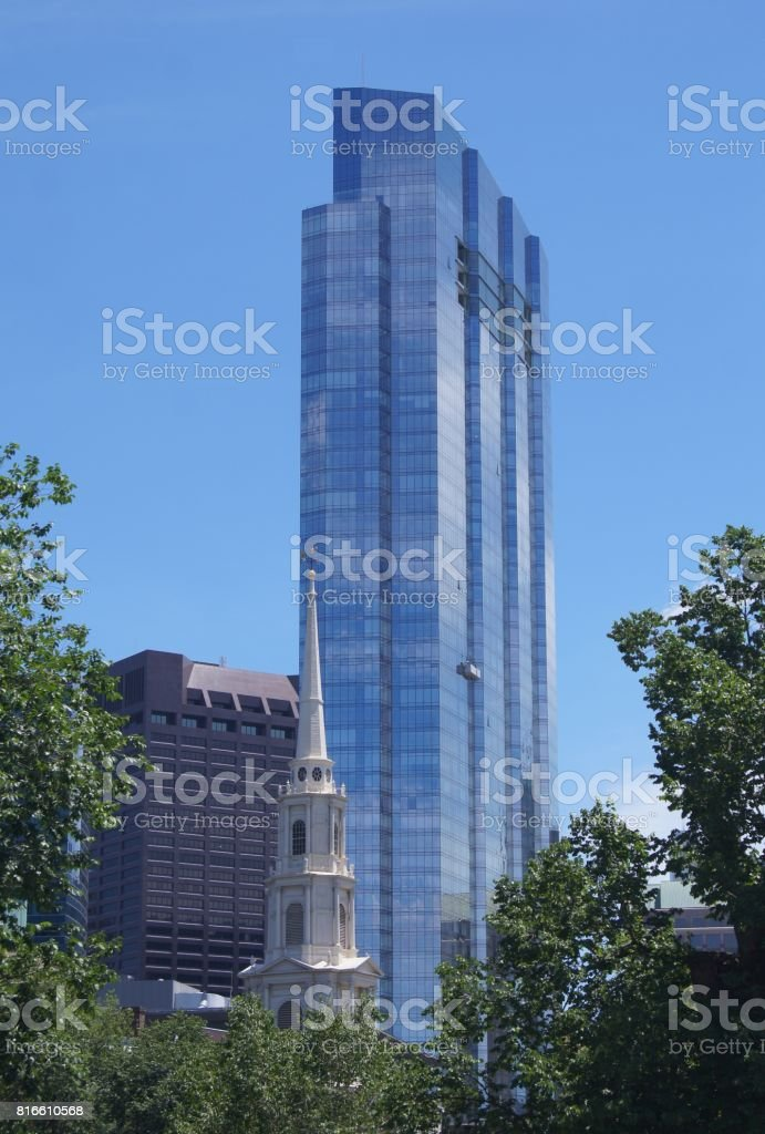 The Millennium Tower Rising Above the Park Street Church in Boston stock photo