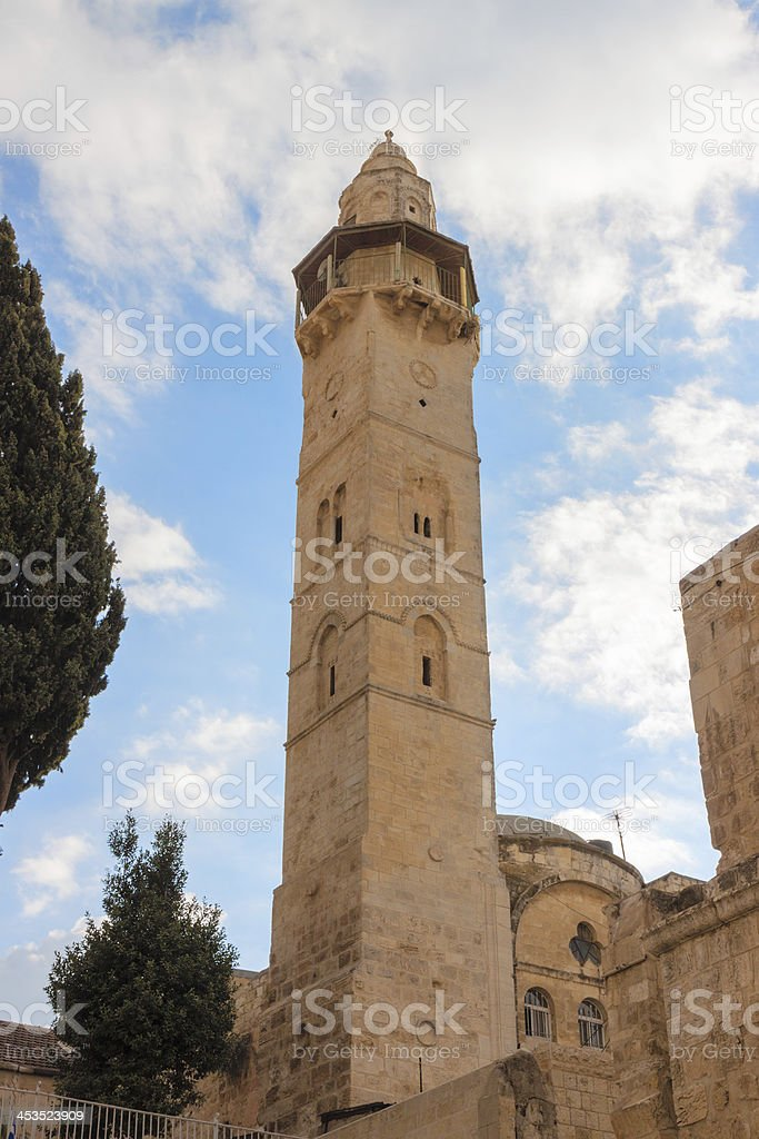 The minaret near a Holy Sepulchre in Jerusalem royalty-free stock photo