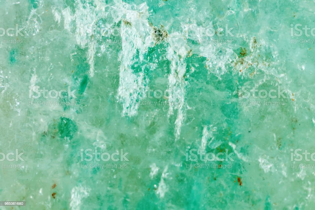 The mineral is jadeite. The texture of the mineral. Macro shooting of natural gemstone. The raw mineral. Abstract background royalty-free stock photo